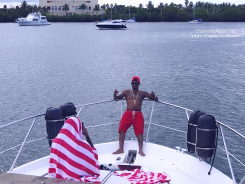 Guy striking a pose on a yacht in Miami