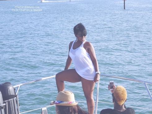 Girl striking a pose on a yacht charter in Miami