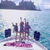 Girls on yacht charter in Miami toasting the sunset