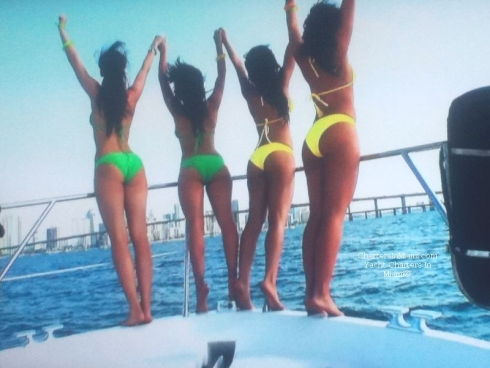 Girls in bikinis on yacht charter in Miami on bow